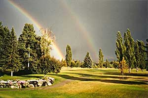 Thunderstorm and rainbow on golf course